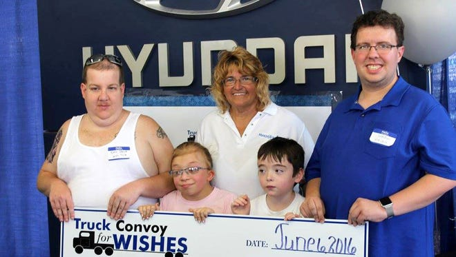Sherri Keller, Truck Convoy for Wishes organizer, center, is shown with Wish kids, from left, Christopher Staub, Shaelyn Brue, Mason Smith and Seth Dunn.