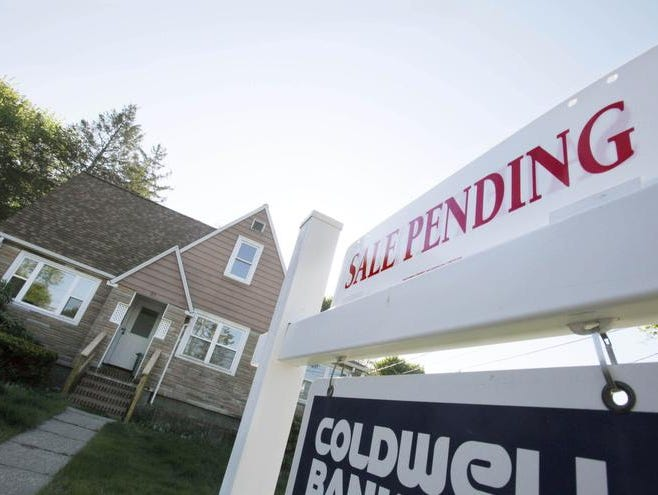 This April 26 file photo shows a pending home sale in Framingham, Mass. Multiple offers and bidding wars have returned to some housing markets amid shrinking supplies of homes for sale. AP/Bill Sikes A sign advertises a pending residential real estate sale in Framingham, Mass., Thursday, April 26, 2012. The National Association of Realtors said the number of Americans who signed contracts to buy U.S. homes rose in March, the latest sign the battered housing market is slowly improving. (AP Photo/Bill Sikes)