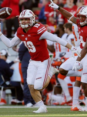 Wisconsin safety Leo Musso (19) celebrates his first interception of the game during the first quarter of their game against Illinois at Camp Randall Stadium on Nov. 12.