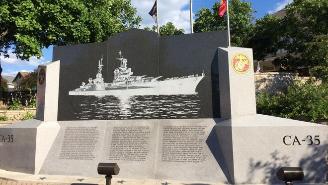 The USS Indianapolis Memorial is at the north end of the Canal Walk (Walnut Street and Senate Avenue) in downtown Indianapolis.