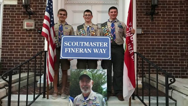 Millburn Boy Scouts, from left, Brian Cariddi, Ryan Cannon and Jamie Serruto, have asked the Millburn Township Committee to name a proposed street on the Mack-Cali property after the late Scoutmaster Ken Fineran.