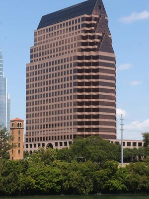 The Austin office tower 100 Congress is on the market, and area real estate experts say its sale could serve as a bellwether for the Austin office market.
