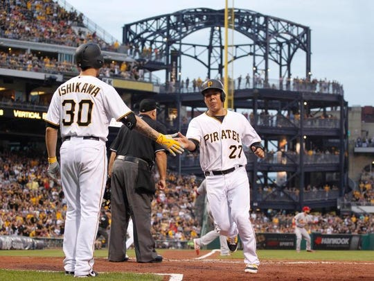 Pittsburgh Pirates left fielder Travis Ishikawa congratulates