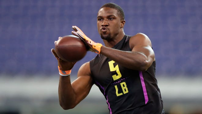 Vanderbilt linebacker Oren Burks runs a drill at the NFL football scouting combine in Indianapolis, Sunday, March 4, 2018.