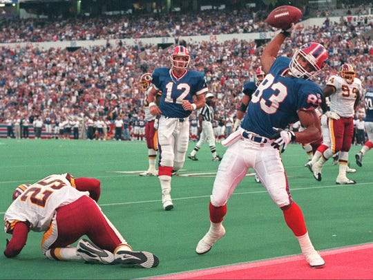Andre Reed celebrates a TD catch from Jim Kelly against the Redskins in 1996.
