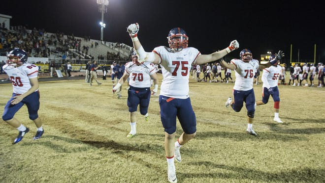 Centennial's Tanner Hawthorne (75) and teammates celebrate a 31-21 win over Mountain Pointe during the Division I state semifinals at Desert Vista High School in Phoenix, AZ on November 20, 2015.
