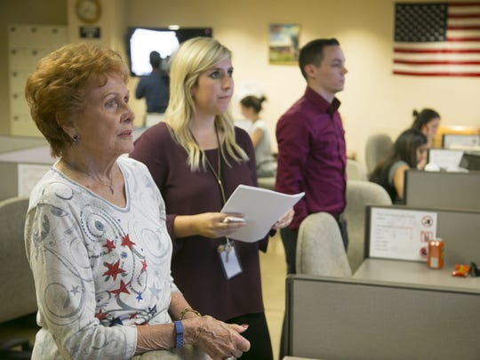 Maricopa County Recorder Helen Purcell (left) watches