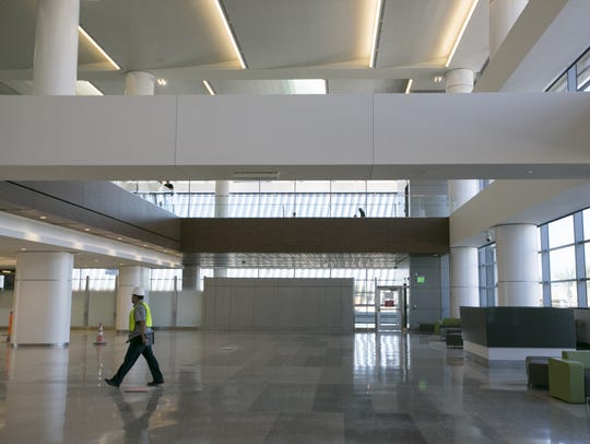 A worker walks through Terminal 3 at Phoenix Sky Harbor
