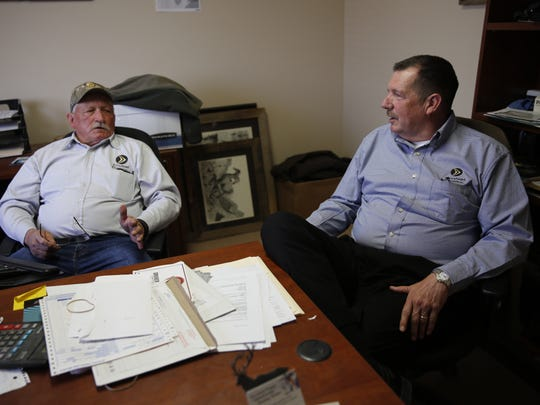 Jake Cluff, left, and Kent Misemer, owners of Arrowhead Propane, talk about giving back to the community at their office earlier this month.