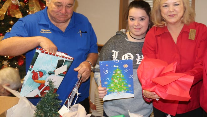 Andy Myrick, and McKenzie Morris and Kate McLendon of Lagniappe Skilled Nursing Facility.