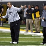 Iowa football team sheds 2 offensive assistants