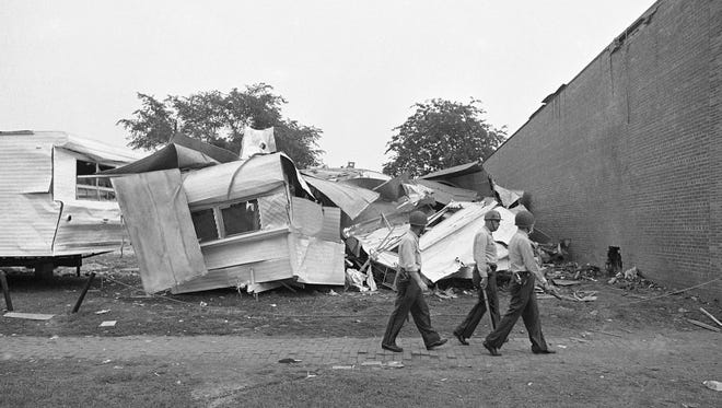 In this May 13, 1963 file photo, police officers patrol past the Gaston Motel, a black motel in Birmingham, Ala., where dynamite dug a large hole in the wall, right, and destroyed eight mobile homes on an adjacent sales lot. The incident set off large scale rioting in the black section. The motel was identified by the National Trust for Historic Preservation as one of America's 11 most endangered historic places.