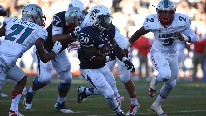 Nevada's James Butler (20) runs free for a touchdown against New Mexico during their football game at Mackay Stadium in Reno on Saturday, Oct. 10, 2015.
