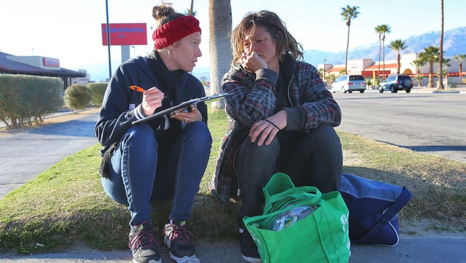Ashley Willis, left, interviews Anjetta Wilson about her living situation in Desert Hot Springs, January 26, 2016.  Volunteers with Riverside County were counting and surveying homeless througout the city Tuesday.