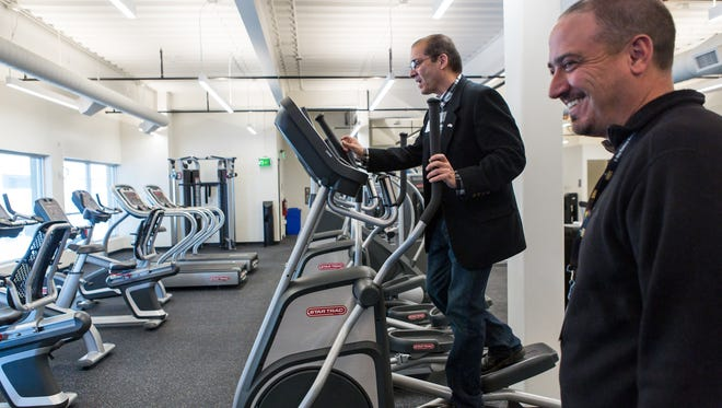 City Councilmember Ray Martinez tries out a machine in the fitness room at the new Foothills Activity Center during the public unveiling at Foothills Mall in Fort Collins on Thursday.