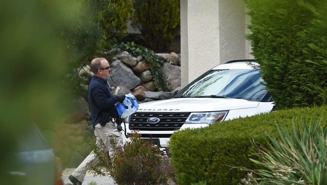 A law enforcement official is seen during a raid on the home of Richard West Jr. in Reno on April 28, 2016.
