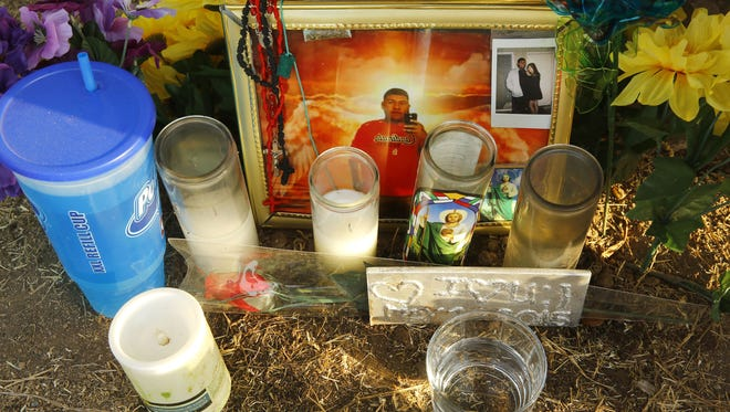 A roadside memorial for Manuel Castro Garcia, 19, sits near  66th Avenue  and West Coronado Road, on June 21, 2016. Garcia was fatally shot while standing outside his home.