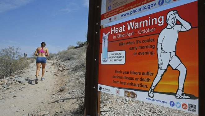 "Melodie Baldwin braves the heat to hike Tuesday, June 21, 2016 at South Mountain Park in Phoenix,  Ariz. Baldwin said she took a break from her daily hikes over the weekend, ""I didn't want to die"" she said."
