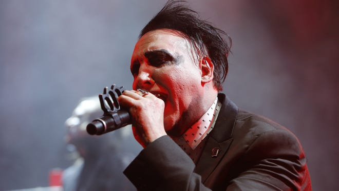 Marilyn Manson performs after a weather delay Saturday, Aug. 20, 2016 in Phoenix,  Ariz.