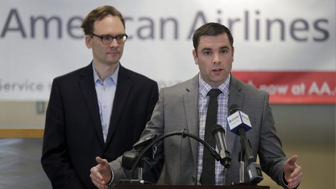 Appleton International Airport director Abe Weber, right, and Outagamie County Executive Tom Nelson announce that American Airlines will add Appleton International Airport to its routes on July 5 Friday at Appleton International Airport in Greenville. The airline will establish two daily flights to Chicago's O'Hare Airport.
