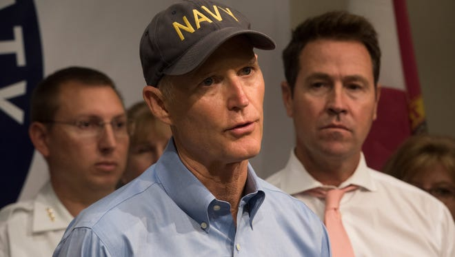 Governor Rick Scott speaks with members of the media after a weather briefing at the Escambia County Emergency Operations Center Friday, Oct. 6, 2017.