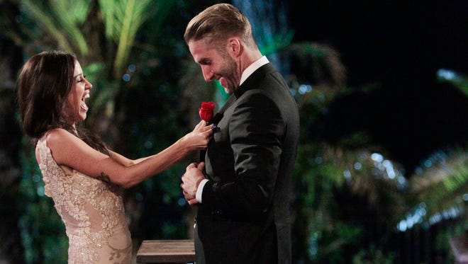 """Kaitlyn Bristowe, left, and Shawn Booth appear on the season finale of """"The Bachelorette."""" The bachelorette and her chosen fiancé are finally able to live their love away from TV cameras after Monday night's  finale where Bristowe chose the 29-year-old personal trainer as her one true love."""