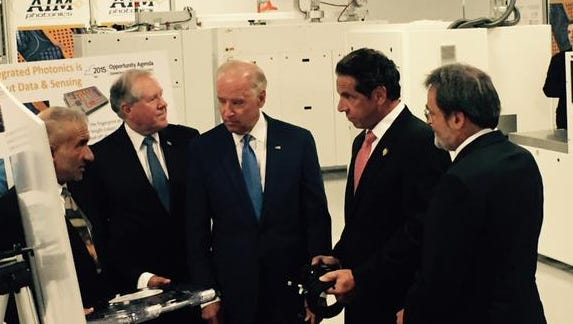 Joe Biden and Andrew Cuomo  get briefed on photonics technology during the event.