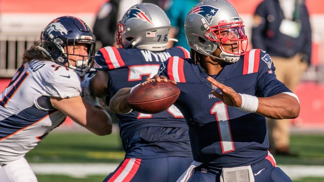 Patriots quarterback Cam Newton struggles against the Denver Broncos defense throwing only 157 yards, no touchdowns, and two interceptions.