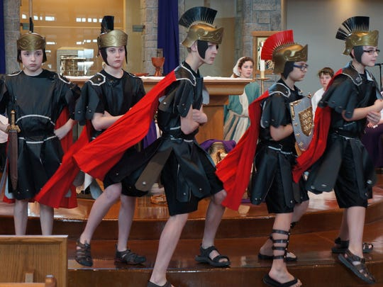 """Roman soldiers Hunter Jordan, left, Max Baus, Tom Koffman, Caleb Smith and Caden Thomas, all students at Shepherd of the Hills Catholic School, practice during a recent dress rehearsal in the school's dramatization of """"The Living Way of the Cross."""""""
