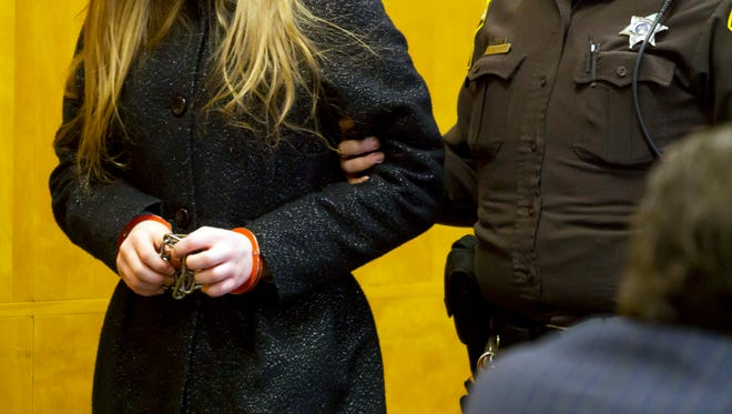 One of two 12-year-old girls accused of stabbing a classmate to please the fictional character Slender Man is led into a courtroom at the Waukesha County Courthouse in Waukesha.