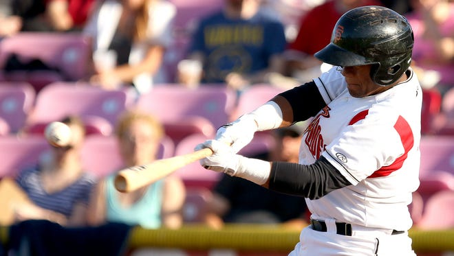 Volcanoes catcher hitter Miguel Gomez with a hit against Boise at Volcanoes Stadium, on Thursday, July 16, 2015, in Keizer, Ore.