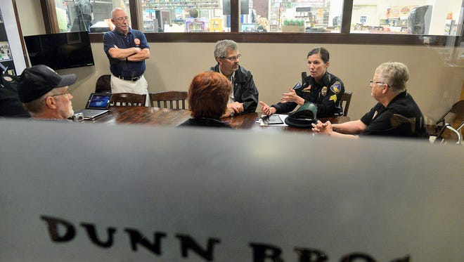 A representative from St. Cloud Police Department talks to a small group of residents and members of the Metro Citizens Police Academy Alumni Association during Coffee with a Cop in November at the Dunn Bros. coffee shop in the Cooper Avenue Coborn's Superstore.