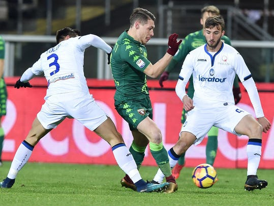Torino's Andrea Belotti, center, and Atalanta's Rafael Toloi vie for the ball during the Italian Serie A soccer match between Torino and Atalanta at the Olympic stadium in Turin, Italy, Saturday, Dec. 2, 2017. (Alessandro Di Marco/ANSA via AP)