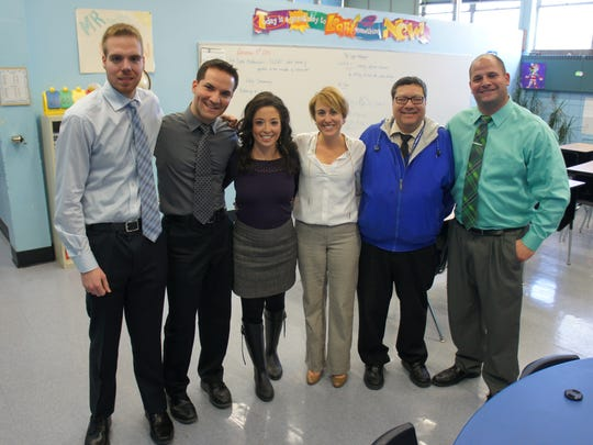 Members of the Sayreville Middle School faculty who participated in the music video were recently interviewed by News12 New Jersey. Pictured, left to right, are: Steven Tyska (history teacher), Patsy Palma (music appreciation teacher), News 12 anchor Cara Di Falco, Kaitlyn Miller (English teacher), Thomas Gentile (humanities supervisor), and Michael Provenza (English teacher).