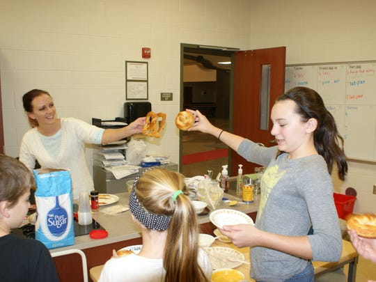 Taylor Sandrock and life skills teacher Erin Olszewski compare pretzels they made in class.