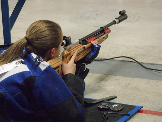 First year shooter Rebecca Spencer used practice time to get used to the large space at the shooting range. She practiced different target heights to prepare for competition.
