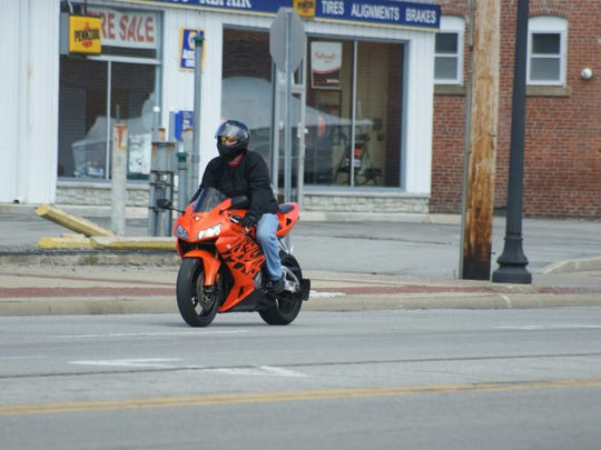 Warmer weather brought the bikes out along Perry Street in Port Clinton.