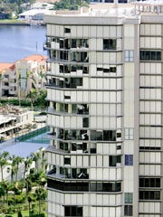 Storm shutters are shown on this condominium in this file photo after Hurricane Wilma ripped through Florida.