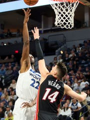 Minnesota Timberwolves' Andrew Wiggins, left, shoots over Miami Heat's Tyler Herro in the first half of an NBA basketball game Sunday, Oct. 27, 2019, in Minneapolis. (AP Photo/Jim Mone)