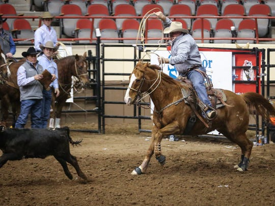 Zane Waldrop rides out in tie down during San Angelo Stock Show and Rodeo slack Tuesday, Feb. 6, 2018, at Foster Communications Coliseum.