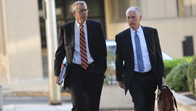 (left)William B. North, 55, former Wilmington Trust chief credit officer, arrives J. Caleb Boggs Federal Building on Monday morning.