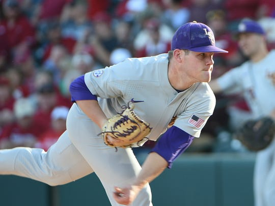 Jared Poche' follows through after a warmup pitch to start for LSU in the second game of the series, April 8, 2017 in Fayetteville, Arkansas. Photo by Chris Daigle Special to the Advertiser