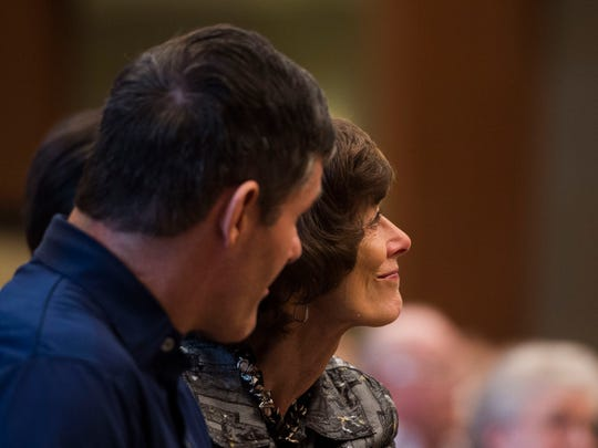 From left retired Air Force Col. Shawn Pederson and his mother Karen look towards the stage during a ceremony officially giving Shawn Smoky Mountains Service Dog Vanner, at Tellico Village Community Church in Tellico, Thursday, March 1, 2018. Pederson retired in 2014 and had a brain aneurysm that disabled him and caused him to need extensive rehabilitation.