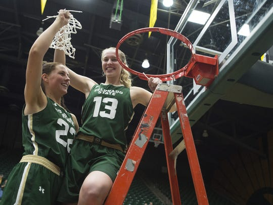 Elin Gustavsson (22) and Ellen Nystrom (13) cut down the net to celebrate CSU women's basketball's fourth Mountain West title in a row in 2017.