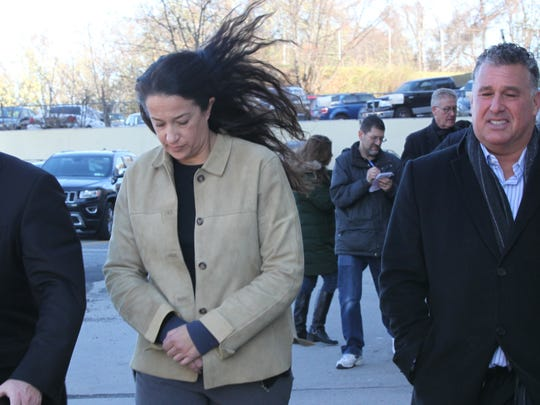 Emily Dearden, an NYPD psychologist, leaves courthouse in Yonkers on Nov. 21, 2014, after posting bail at $150,000 after being charged with attempted murder in the shooting of her husband, developer Kenneth Dearden, on Nov. 14, 2013, as he slept in their Yonkers home.