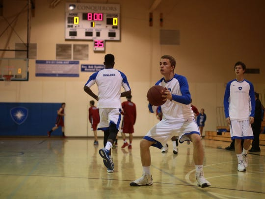 Desert Christian forward Will Whitaker warms up with
