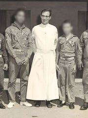 Father Louis Brouillard with Boy Scouts.