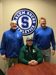 Salem senior lineman Alex Howie is flanked by Rocks football coaches Kevin Biga (left) and Kurt Britnell. Howie signed to play for Eastern Michigan University.