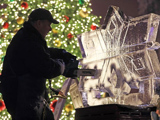Ice sculpter Bill Gorish creates a masterpiece during the 16th annual Holiday Promenade in the Historic East Village of Des Moines on Friday, Nov. 17, 2017.  The festive event features boutique shopping, free ice skating at the Brenton Skating Plaza, caroling, tree lighting, a visit from Santa, live ice sculpting, and free horse-drawn trolley rides.