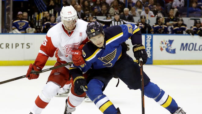 Detroit Red Wings' Mike Green, left, and St. Louis Blues' Colton Parayko chase after the puck during the second period of an NHL hockey game Thursday, Oct. 27, 2016, in St. Louis.